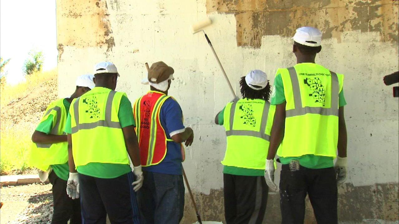 Young painters were seen sprucing up a viaduct near 89th and Morgan as part of the program.
