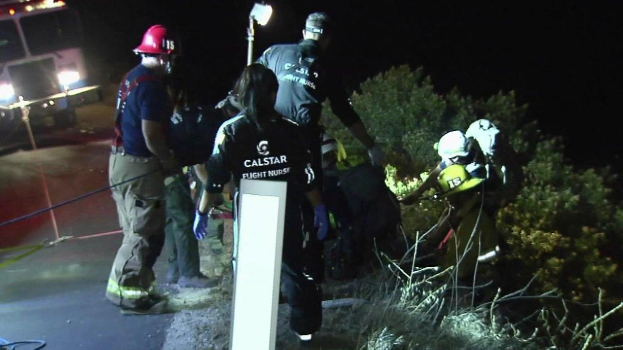 Firefighters rescue a man who drove off of a 400-foot embankment near Santa Barbara.
