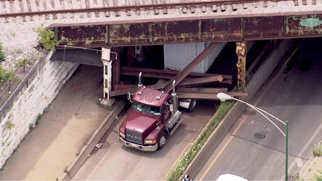 Semi stuck under 63rd Street rail bridge on South Side
