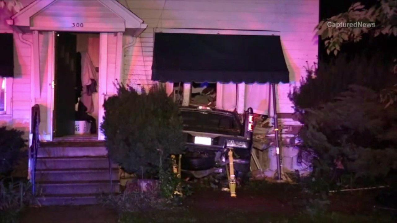 Truck crashes into house in Dwight