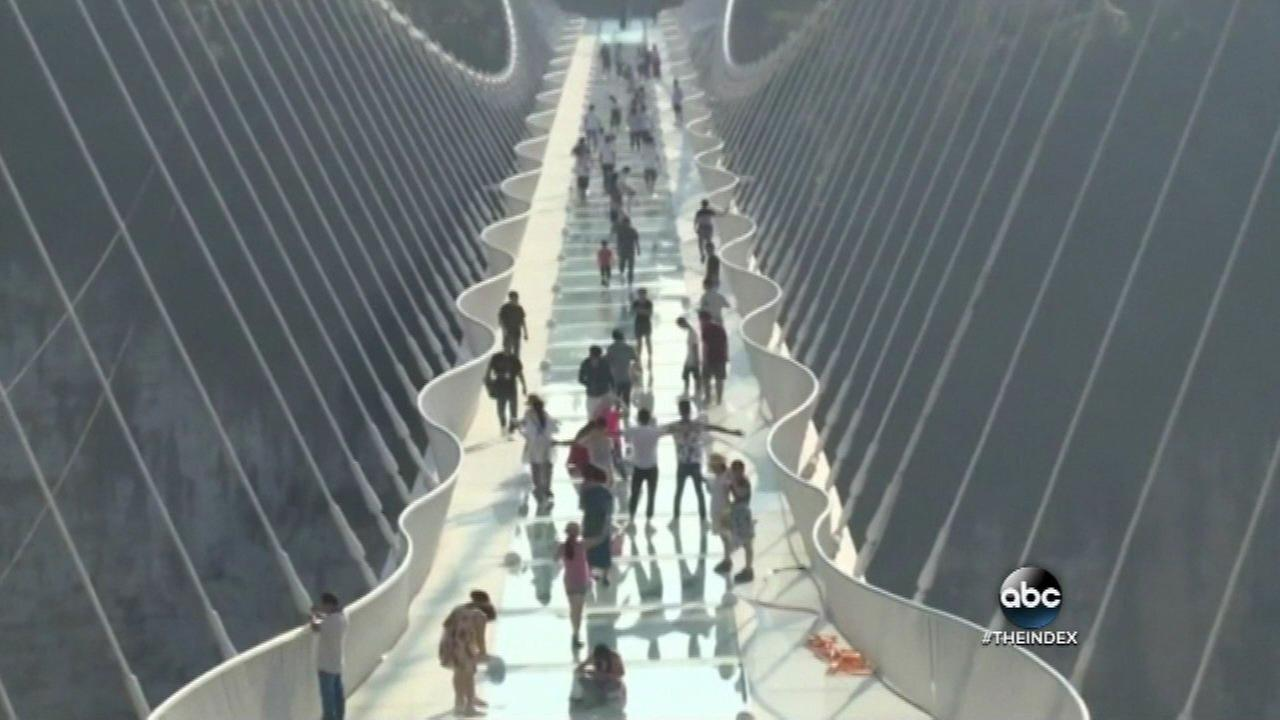 China opens world's highest, longest glass bridge