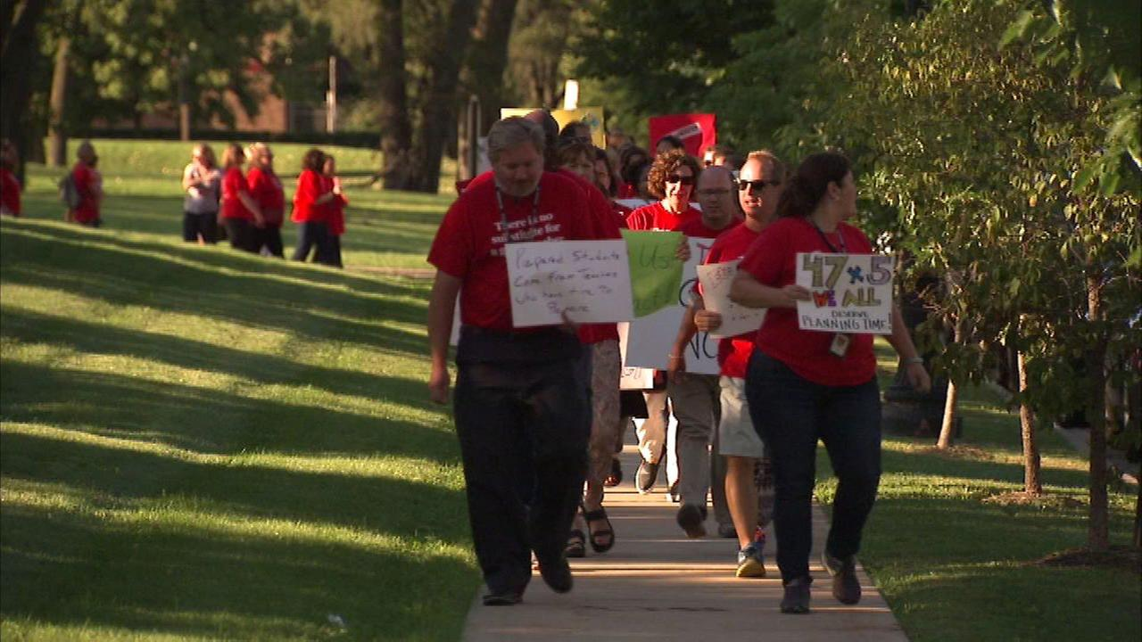 Demonstrators picket suburban school board meeting