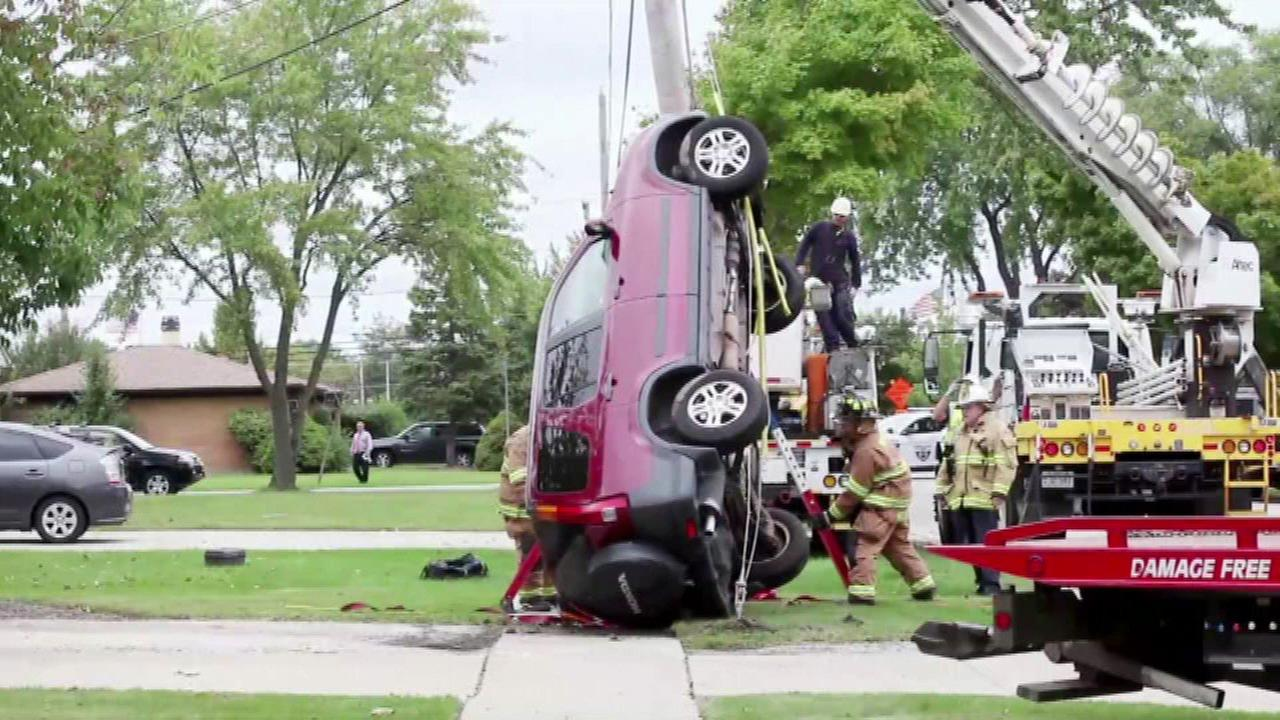 Driver saved after driving up light pole