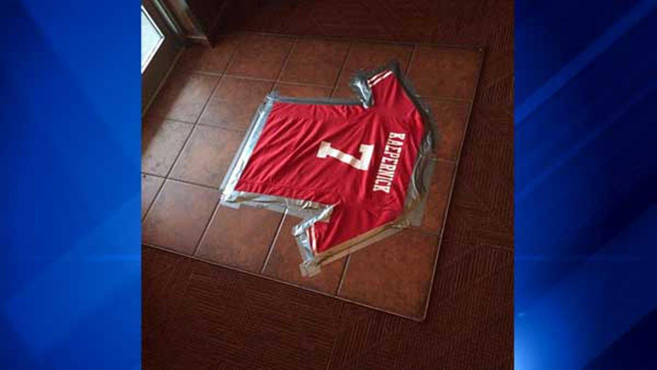Kaepernick jersey taped to restaurant floor