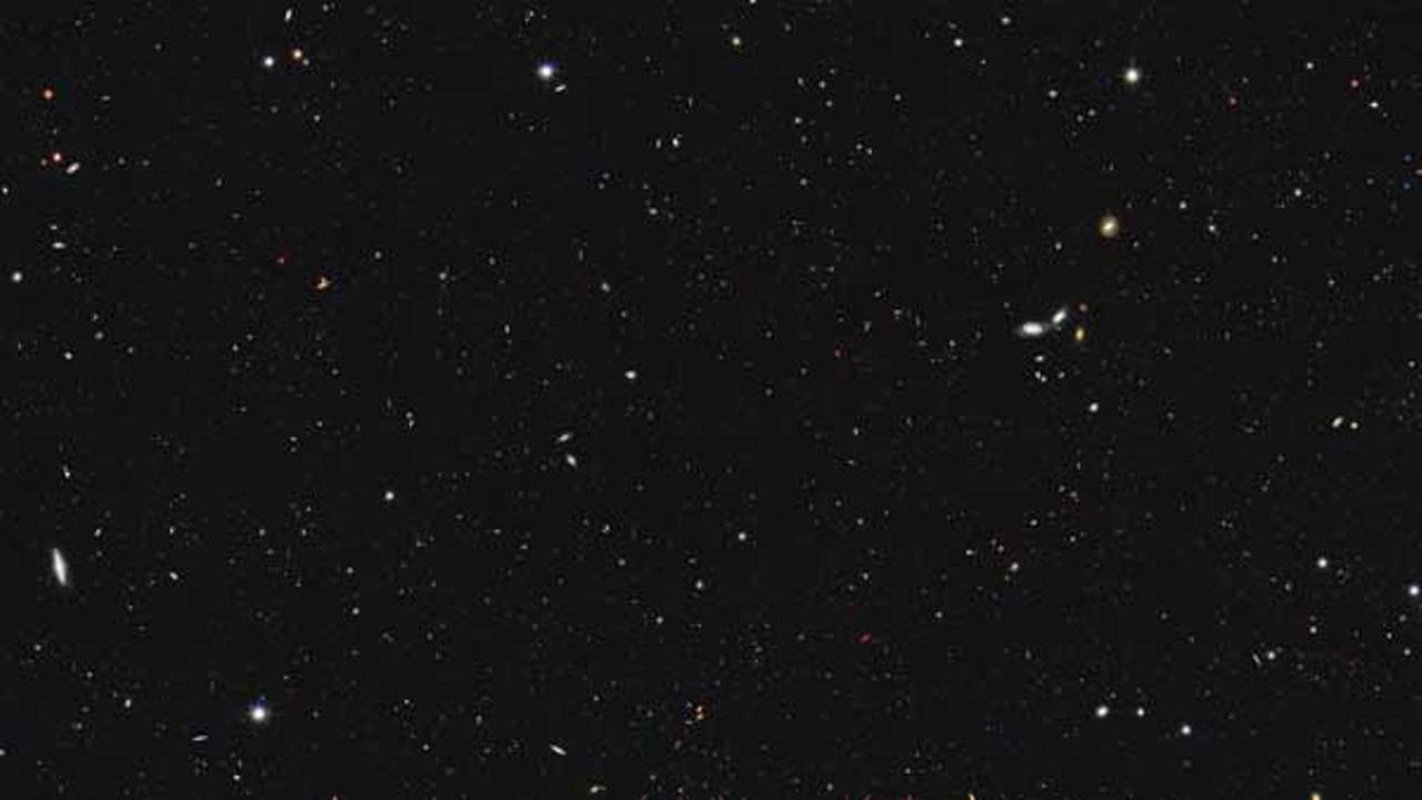 This image made available by NASA, ESA/Hubble shows a portion of the southern field of the Great Observatories Origins Deep Survey to recalculate the total number of galaxies in the observable universe.