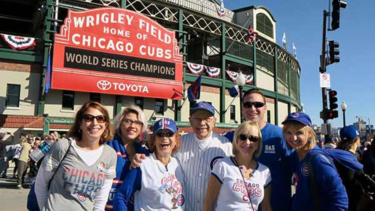 Marlene and Stan Wiet and their family pose in front of the Wrigley Field marquee on Nov. 3, 2016.