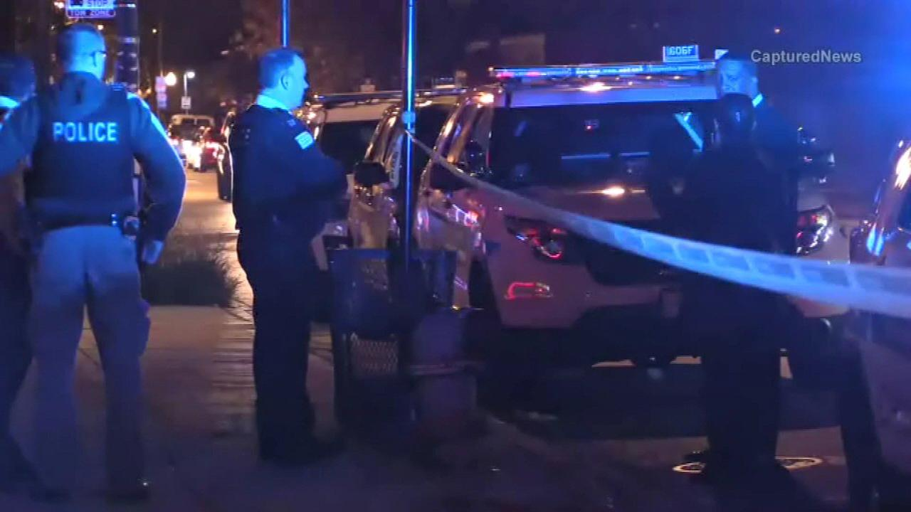 Chicago police investigate after a man was shot to death in the first block of East 75th Street.