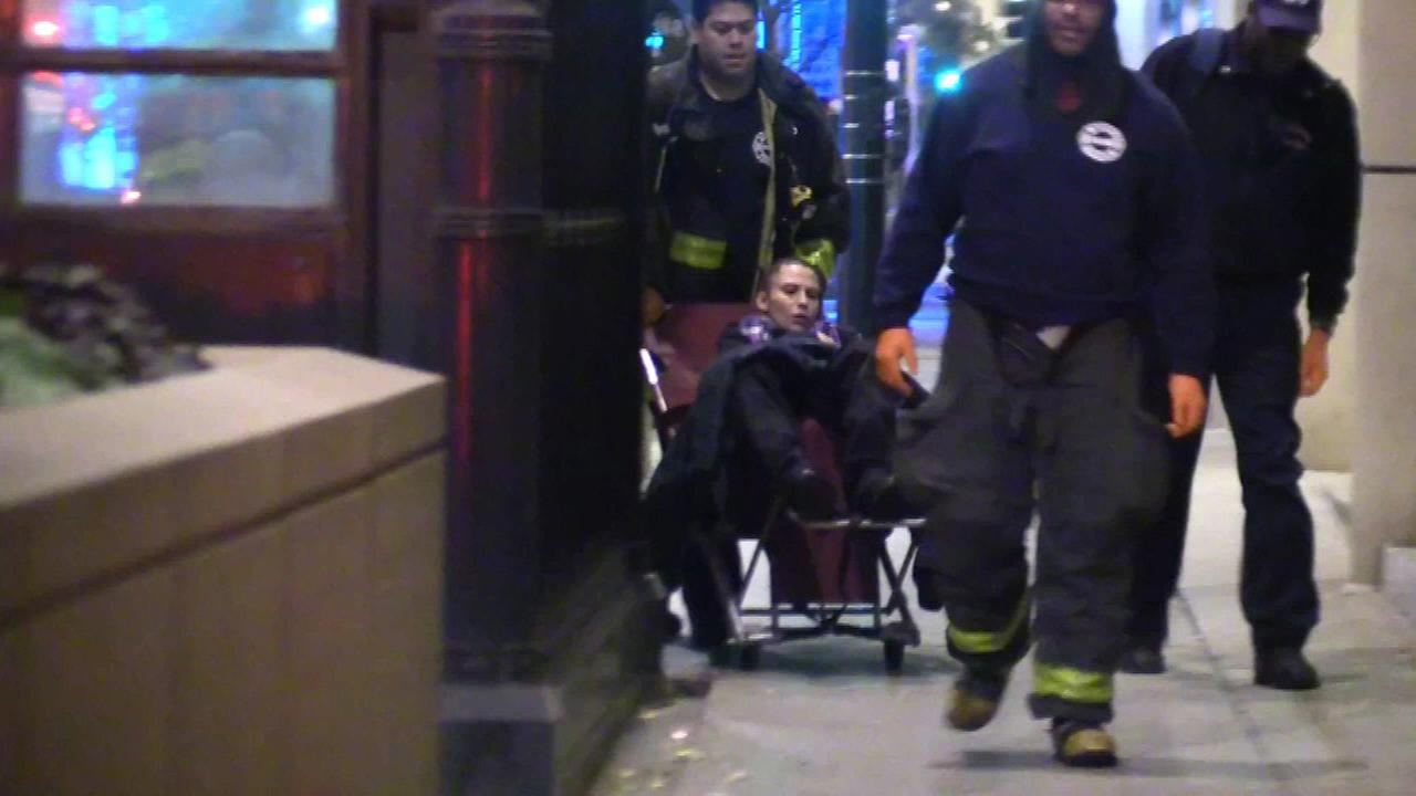 Firefighters transport a woman after she gave birth at a CTA Blue Line station.