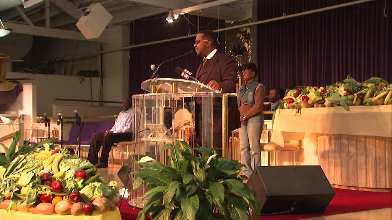 Earl Walker receiving a humanitarian award from Holy Spirit Church.