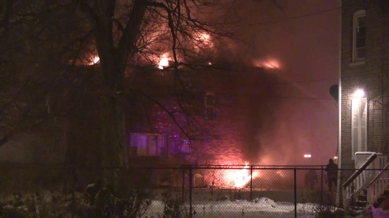 Englewood house fire forces 12 to escape