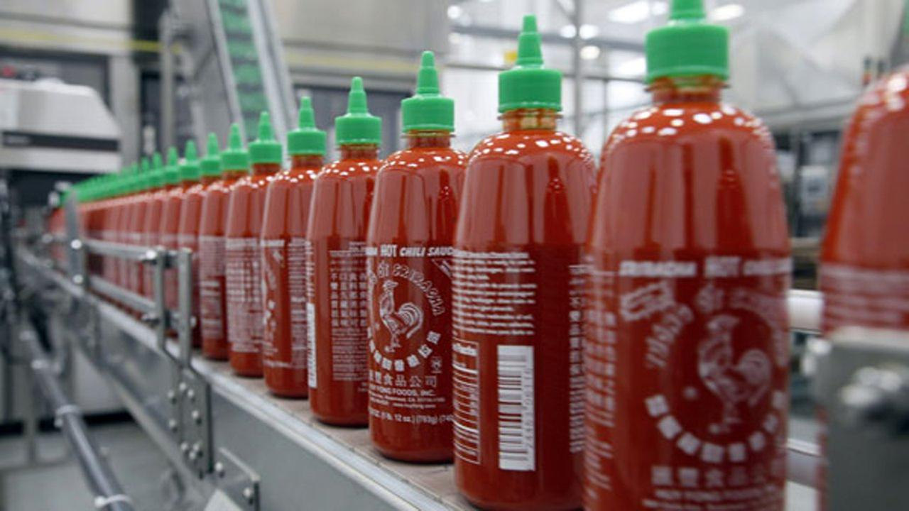 In the Tuesday, Oct. 29, 2013, file photo, Sriracha chili sauce is produced at the Huy Fong Foods factory in Irwindale, Calif.