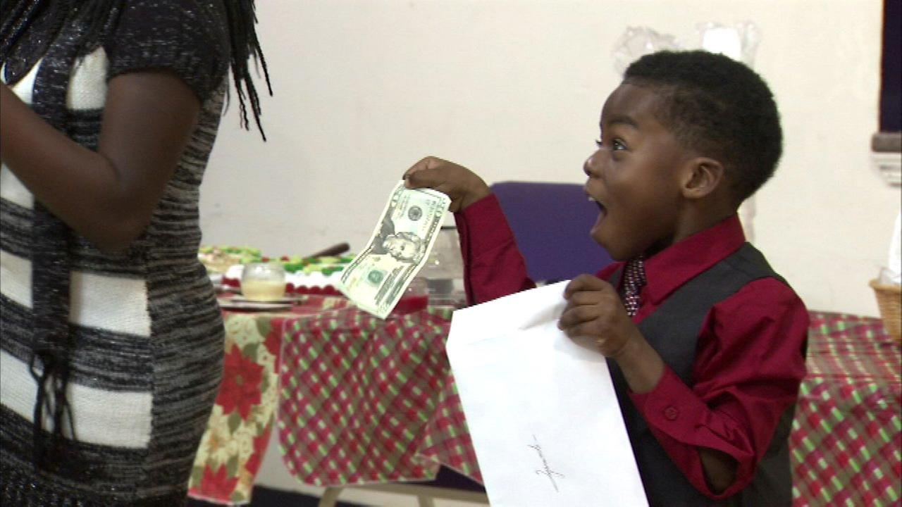 Tyrone Hardins three children received Christmas gifts donated by the community.