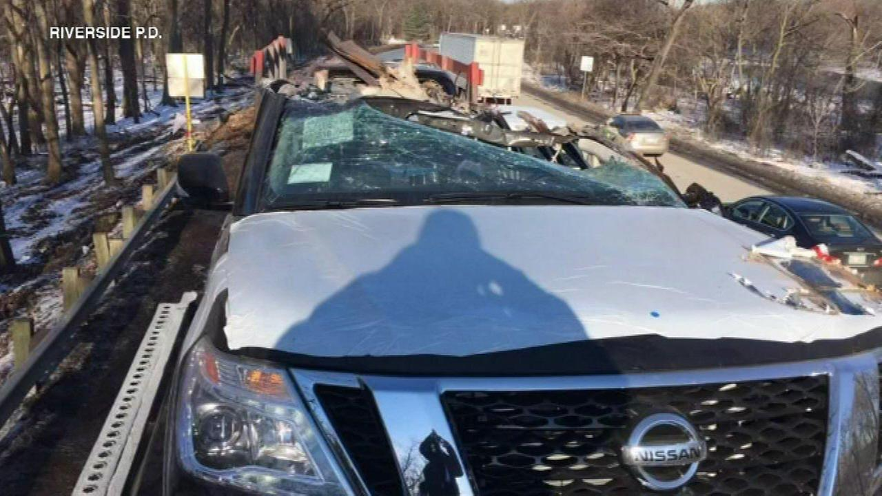 News cars damaged after carrier truck fails to clear bridge