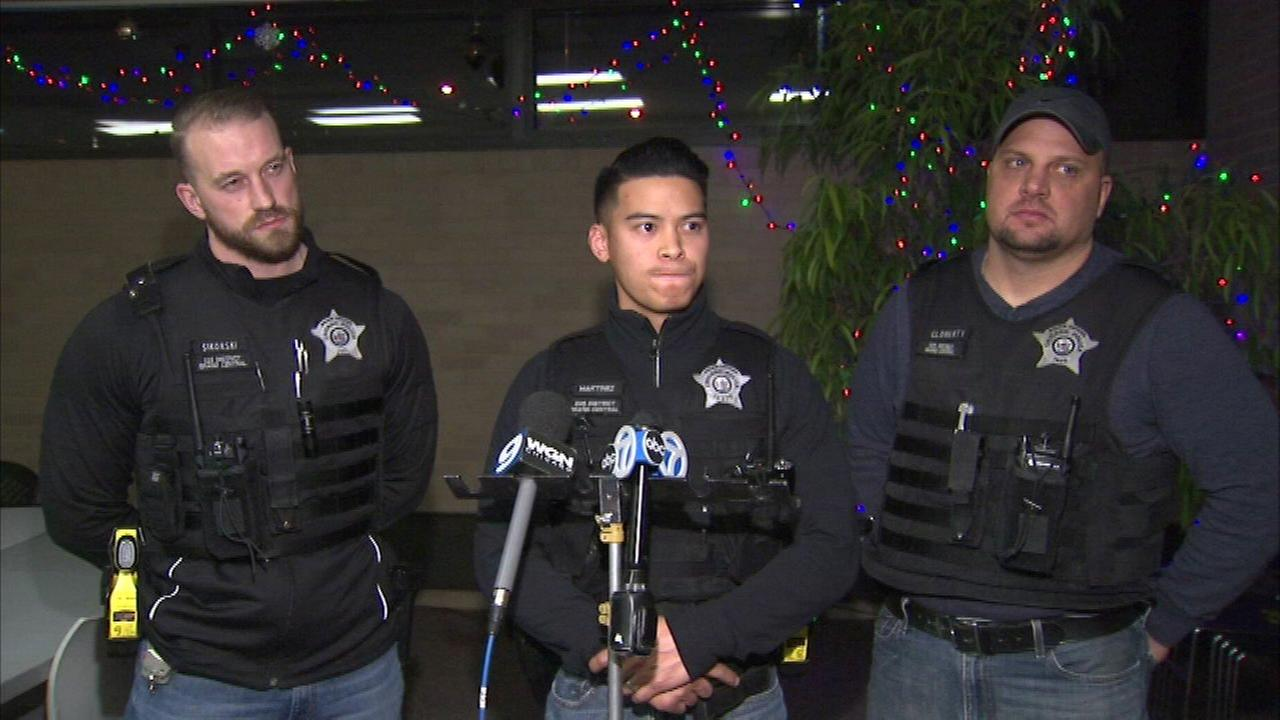 Three Chicago police officers are credited with saving a man having a heart attack int he Humbold Park neighborhood.