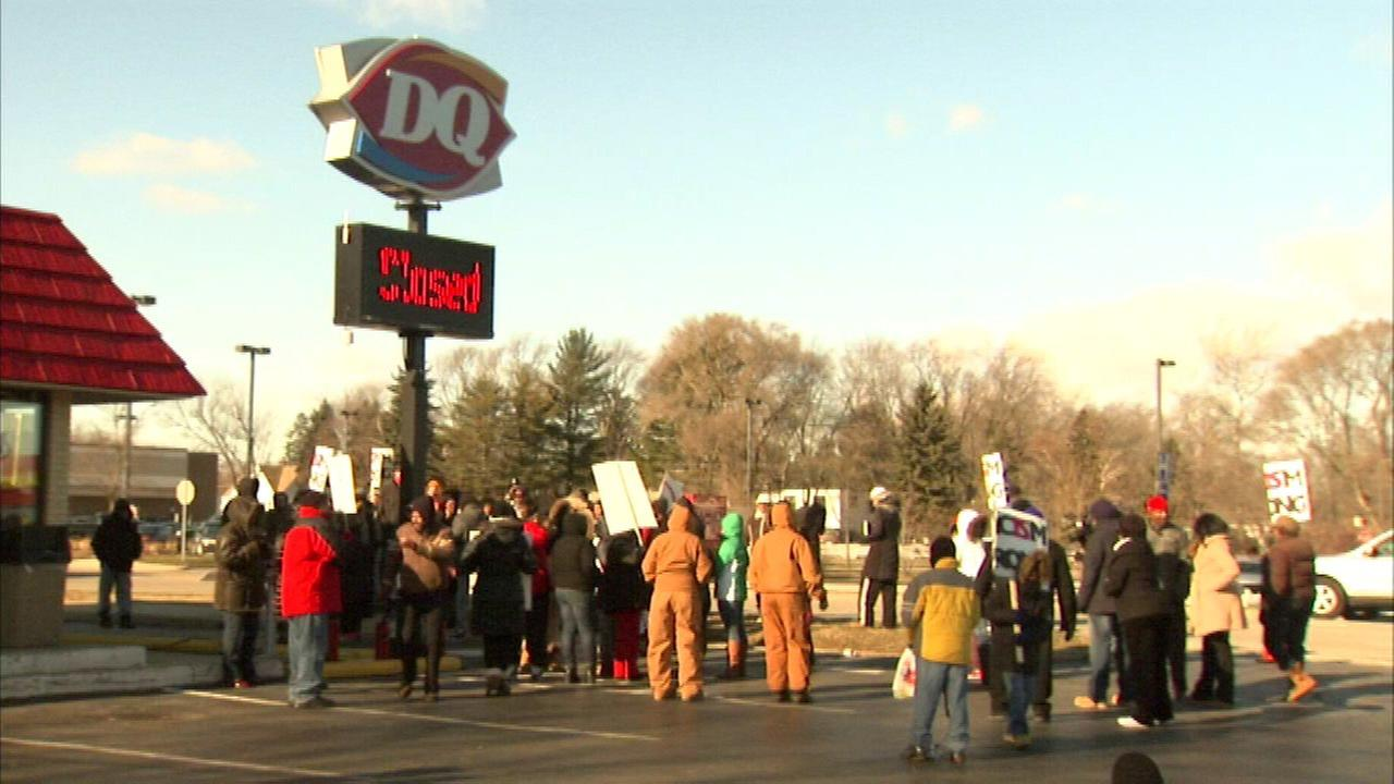 Protesters outside a now closed Zion Dairy Queen after a franchisee used racial slurs against a customer.