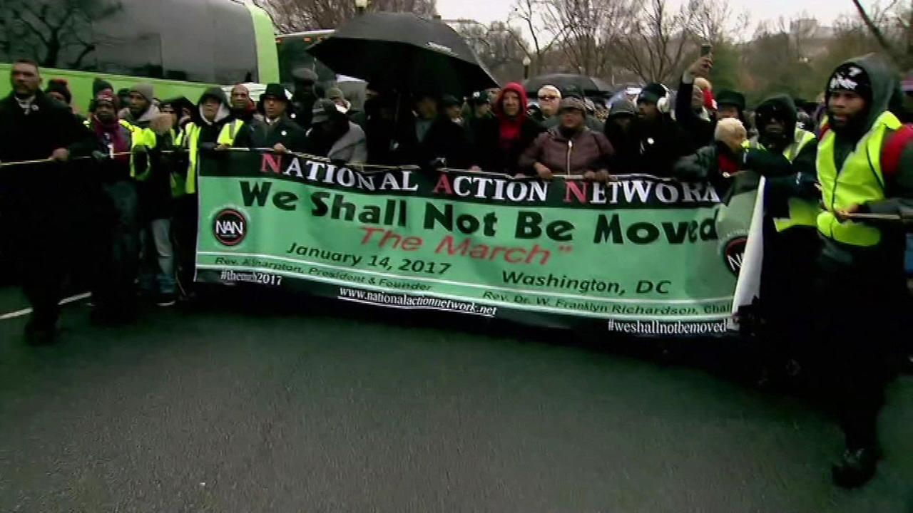 Ahead of inauguration, thousands rally for immigration and civil rights