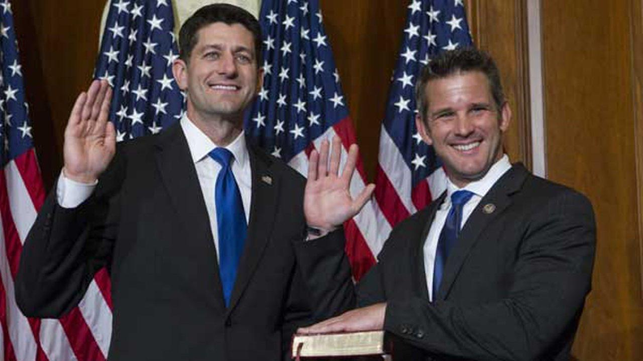 House Speaker Paul Ryan of Wis. administers the House oath of office to Rep. Adam Kinzinger, R-Ill., during a mock swearing in ceremony, as the 115th Congress began.