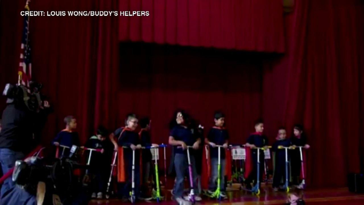 Students get bikes, scooters at Logan Square elementary school
