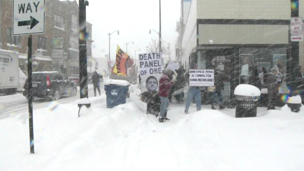 Protesters march outside Ryan's WI office over GOP healthcare plan