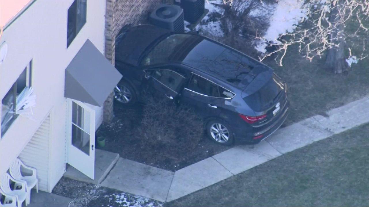 Car crashes into Woodridge townhouse