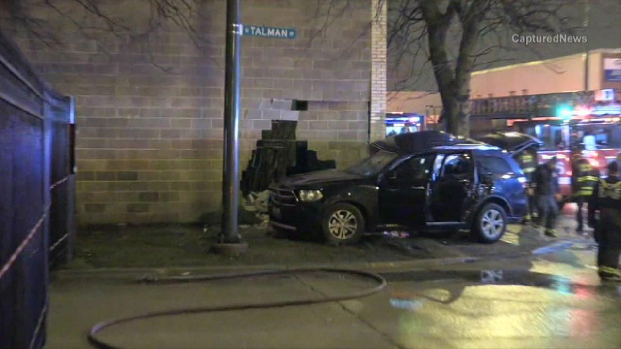 Chicago police investigate a deadly crash after an SUV struck a building on the West Side.