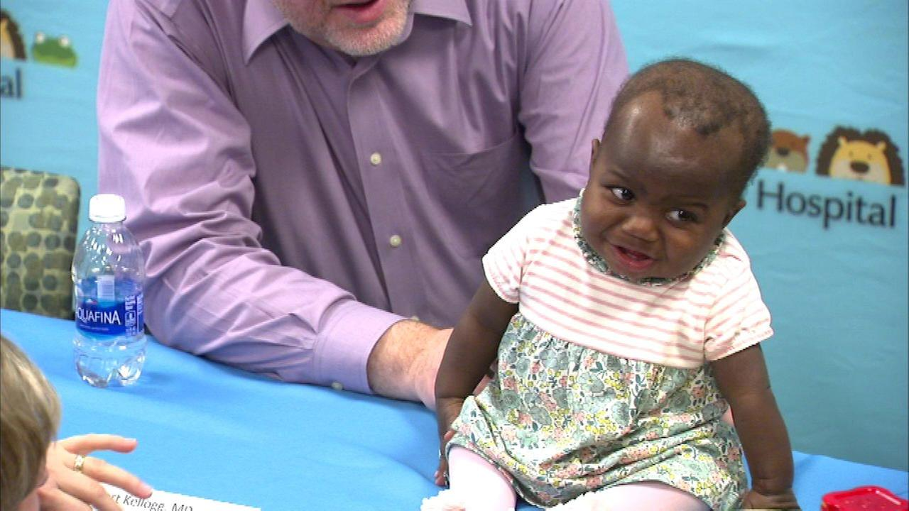 Baby born with 4 legs, 2 spines returns home to Ivory Coast after surgery