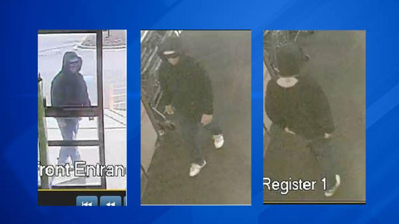 Surveillance photos of a robbery suspect.