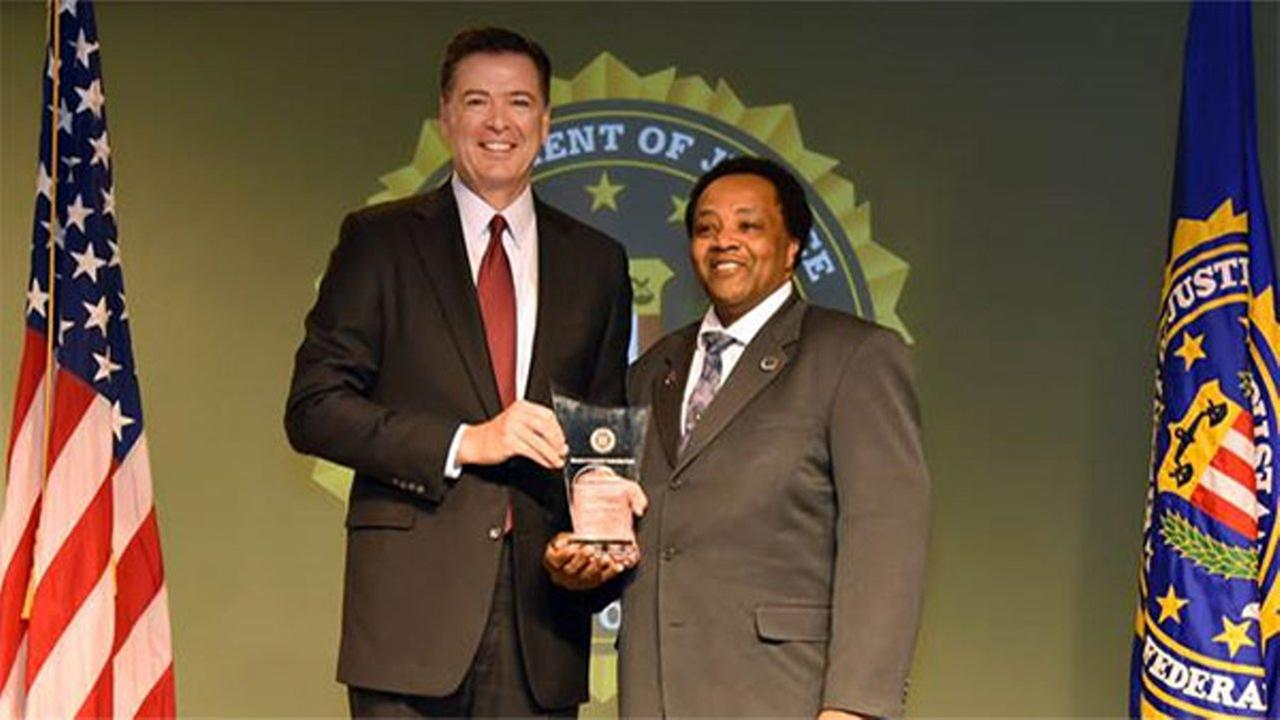 Andrew Holmes honored with leadership award from FBI