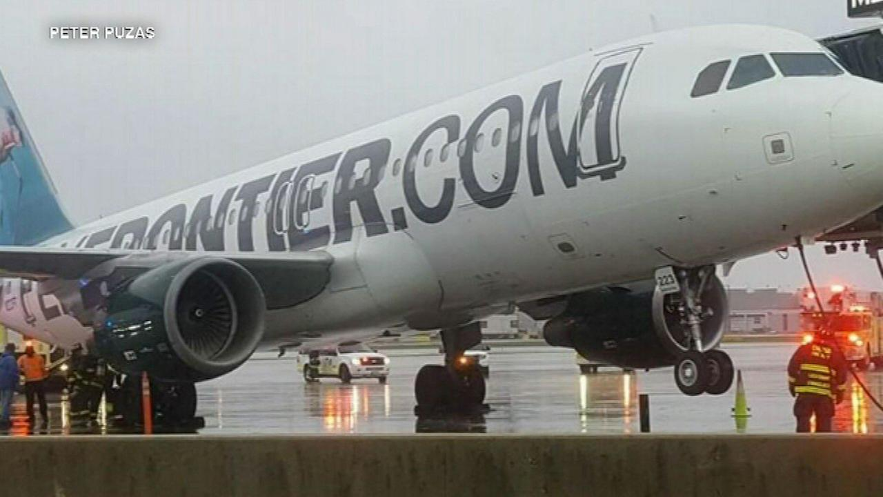 Plane tilts at OHare Airport