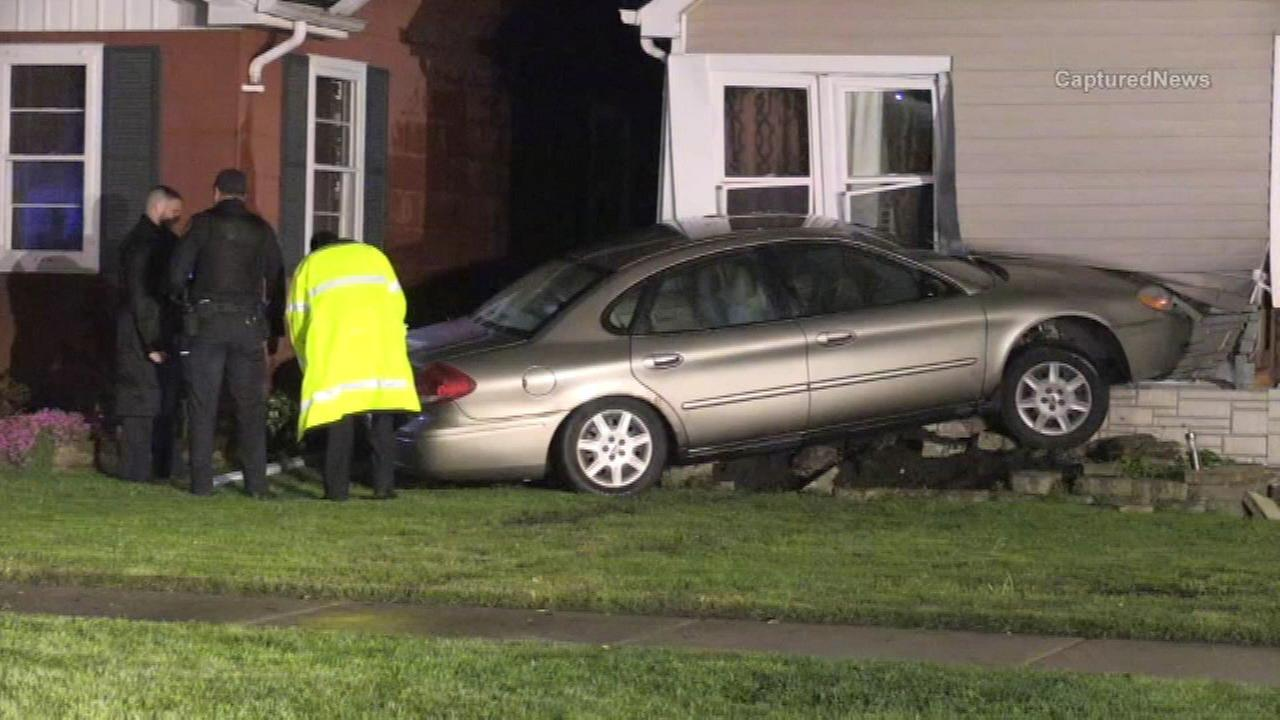 Authorities investigate after a car crashed into a home in south suburban Oak Lawn,