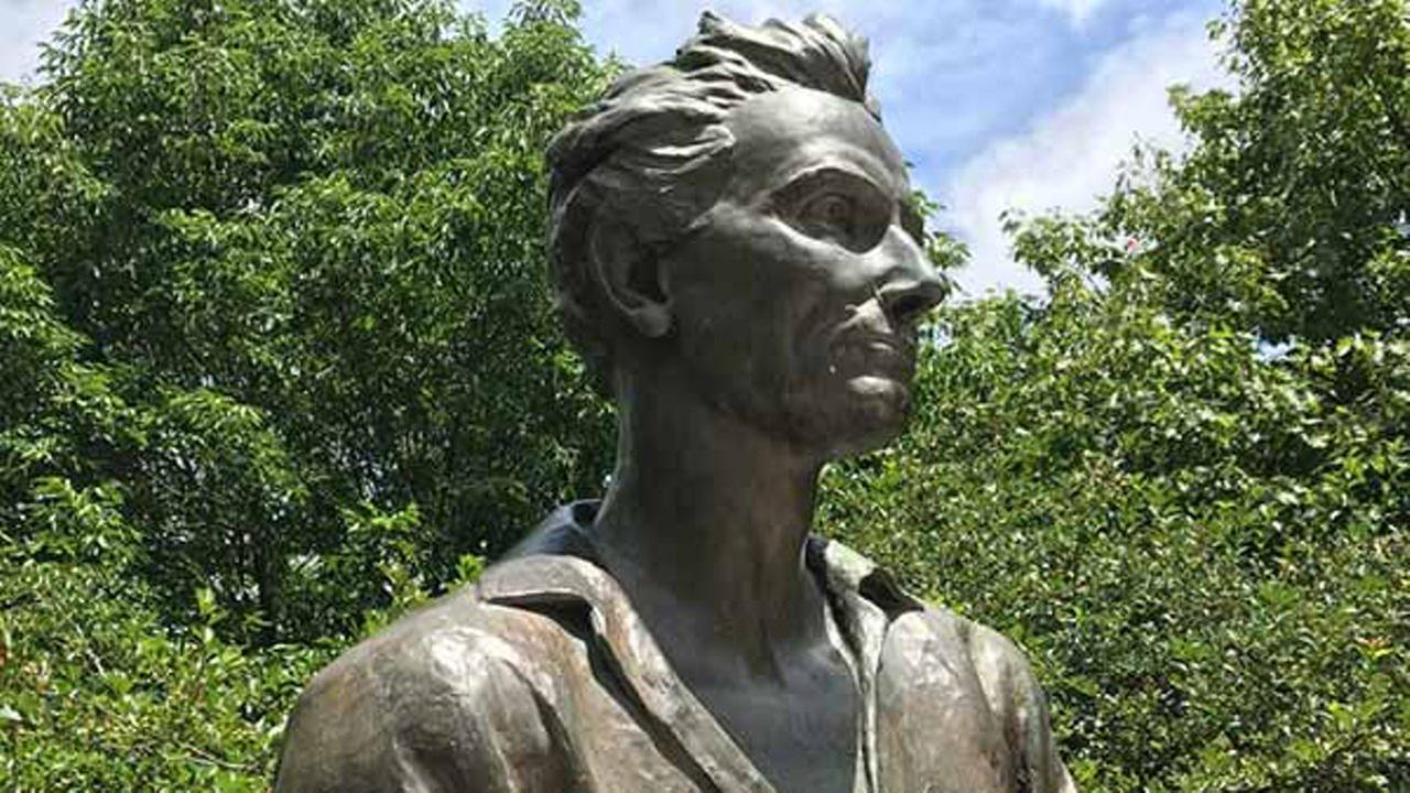 The statues flowing hair, half-buttoned shirt and muscular arms have some on the internet calling him Baberham Lincoln.