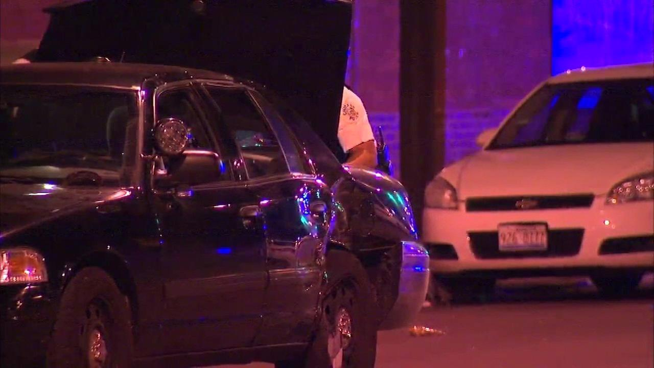 Four Chicago police officers were among five injured in a crash in the East Garfield Park neighborhood on Friday.
