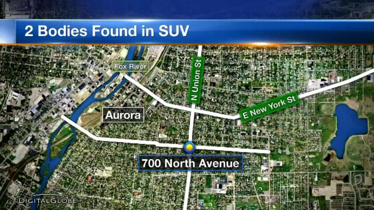 Two men were found dead in a car in west suburban Aurora Thursday morning, police said.