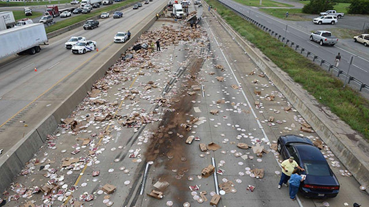 This Aug. 9, 2017 photo shows Arkansas highway I-30, a cross-country route that was shut down in both directions after an 18-wheeler was sliced open and spilled frozen pizzas.