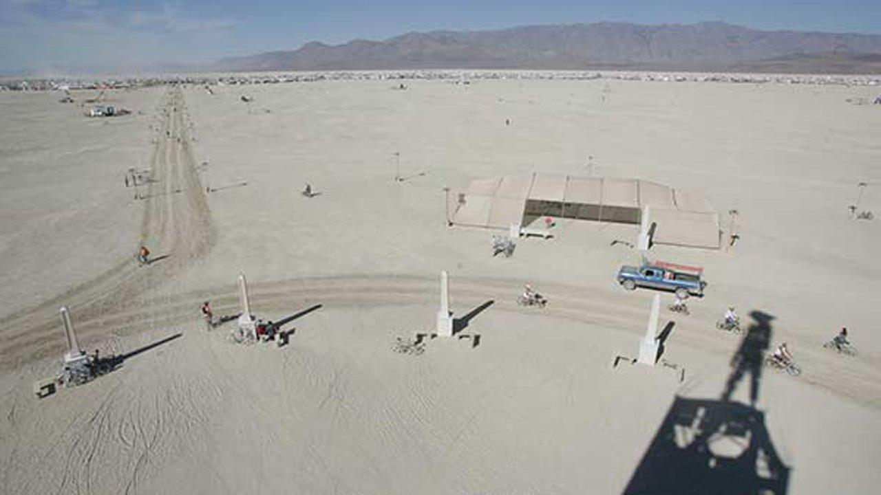 Burning Man participants view The Man on Tuesday, Aug. 26, 2008, at the Black Rock Desert near Gerlach, Nev.