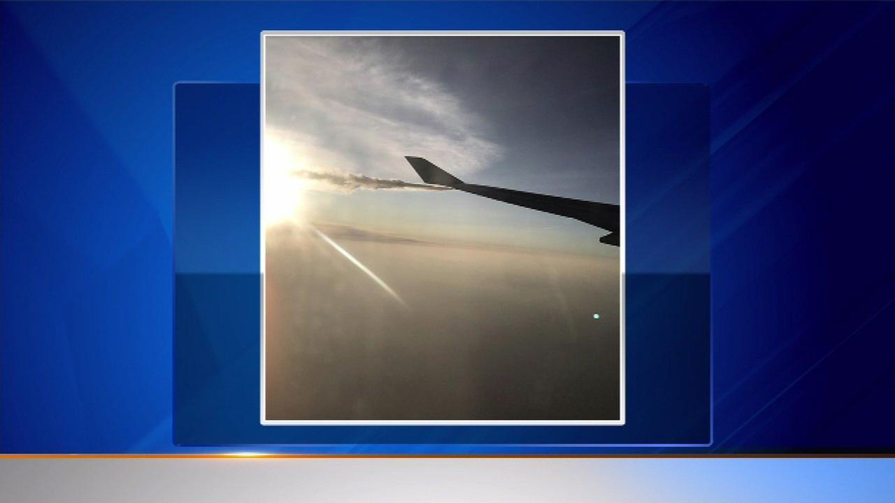 An ABC7 viewer sent in a photo of a British Airways plane dumping fuel over Lake Michigan after an engine failed on the plane.