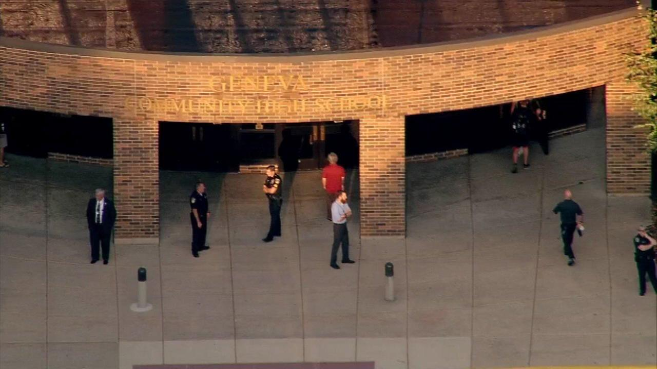 Police stand guard outside Geneva High School after rumors of planned shooting