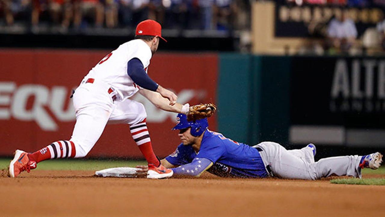 Chicago Cubs Willson Contreras, right, is safe at second ahead of the tag from St. Louis Cardinals second baseman Greg Garcia Tuesday, Sept. 26, 2017, in St. Louis.