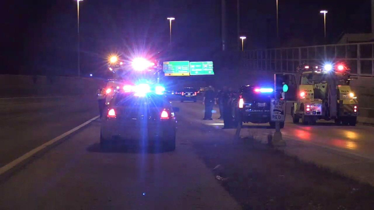 Police investigate a crash on a ramp to the Eisenhower Expressway after a shooting in Bellwood Saturday morning.
