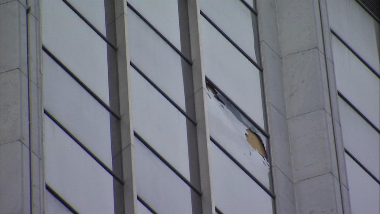 Police closed Randolph Street between LaSalle to Franklin streets after glass fell from a high-rise.