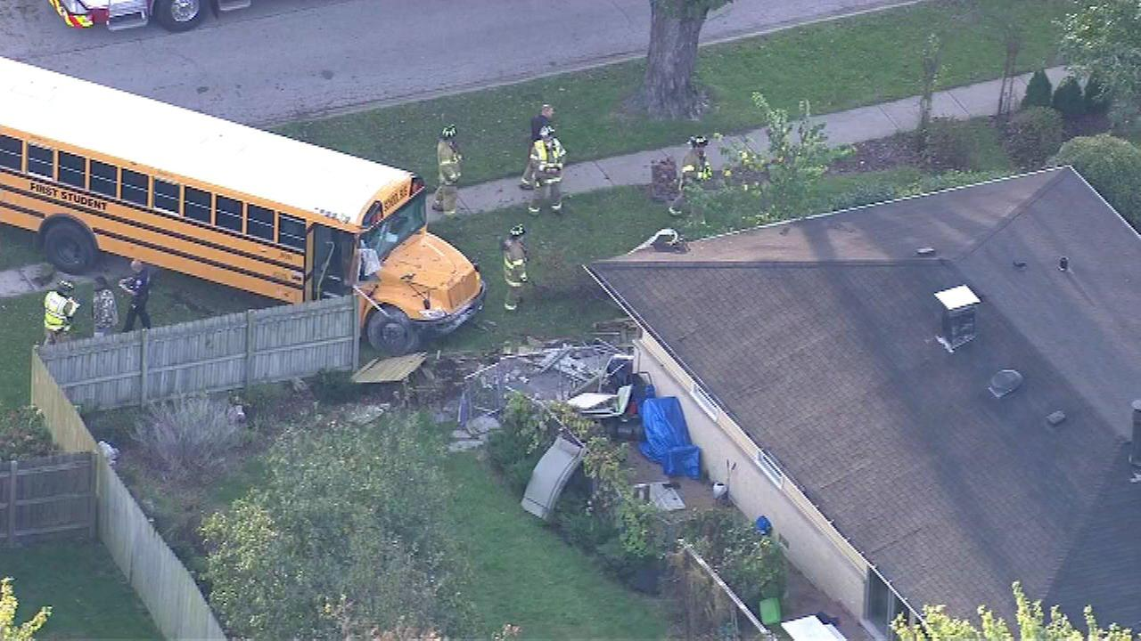 School bus hits Elk Grove Village house