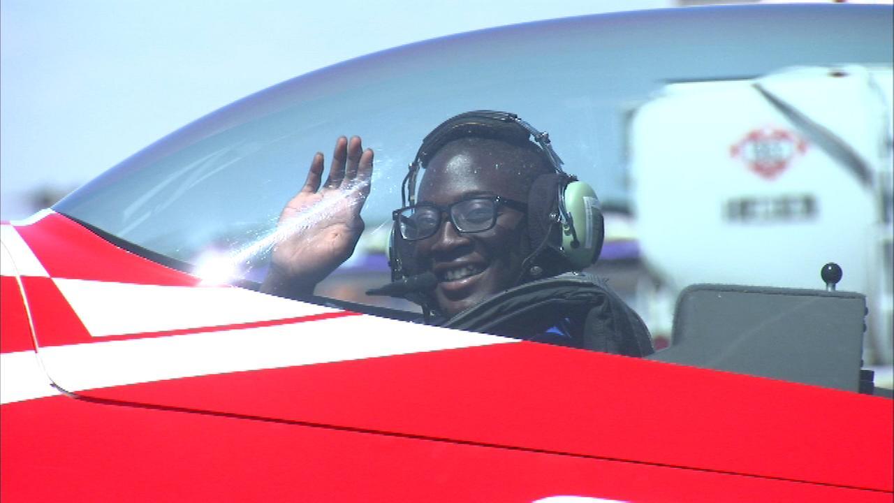 Student Malik Baker flies alongside Blue Angels