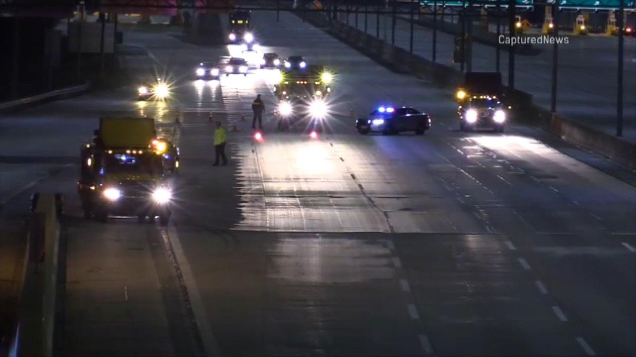 Police investigate a shooting on the Tri-State Expressway in Alsip Sunday morning.