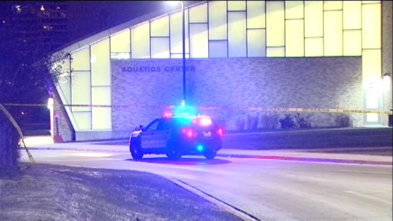 Police investigate a report of shots fired outside Niles North High School after a basketball game.