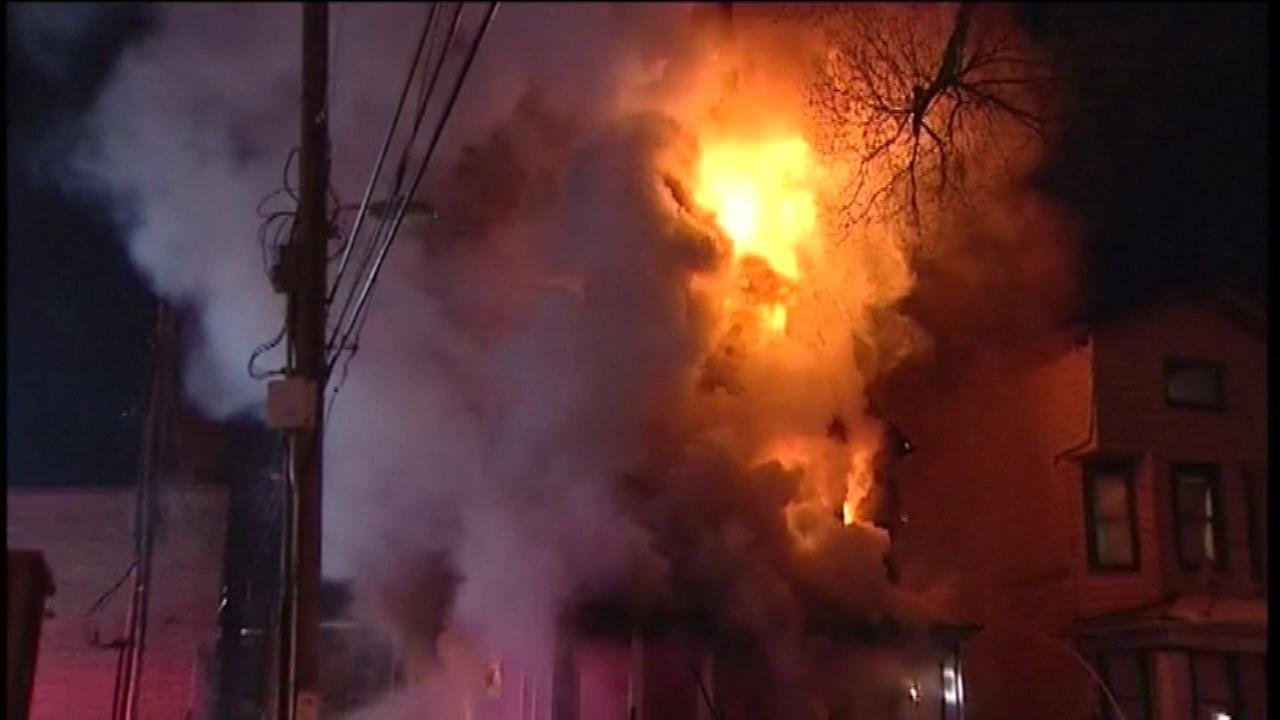 A downed power line trapped firefighters in the yard of a burning home Thursday morning.