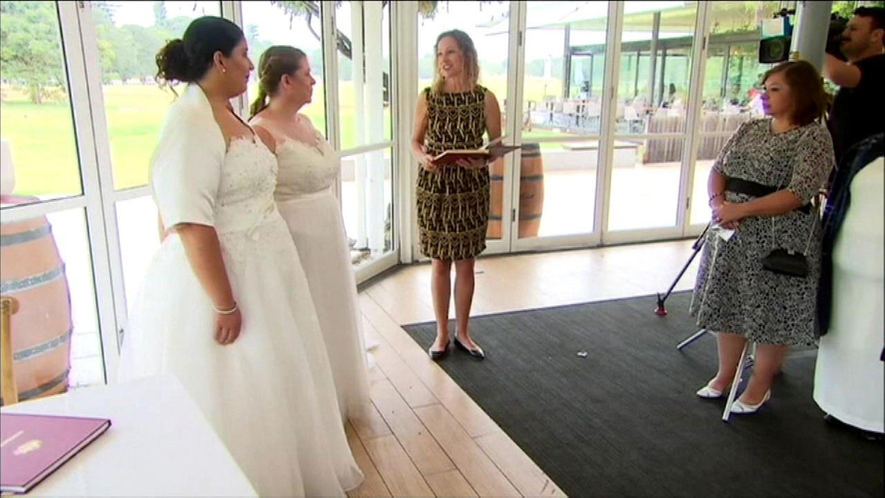 Moments after midnight, Australian same-sex couples say 'I do'