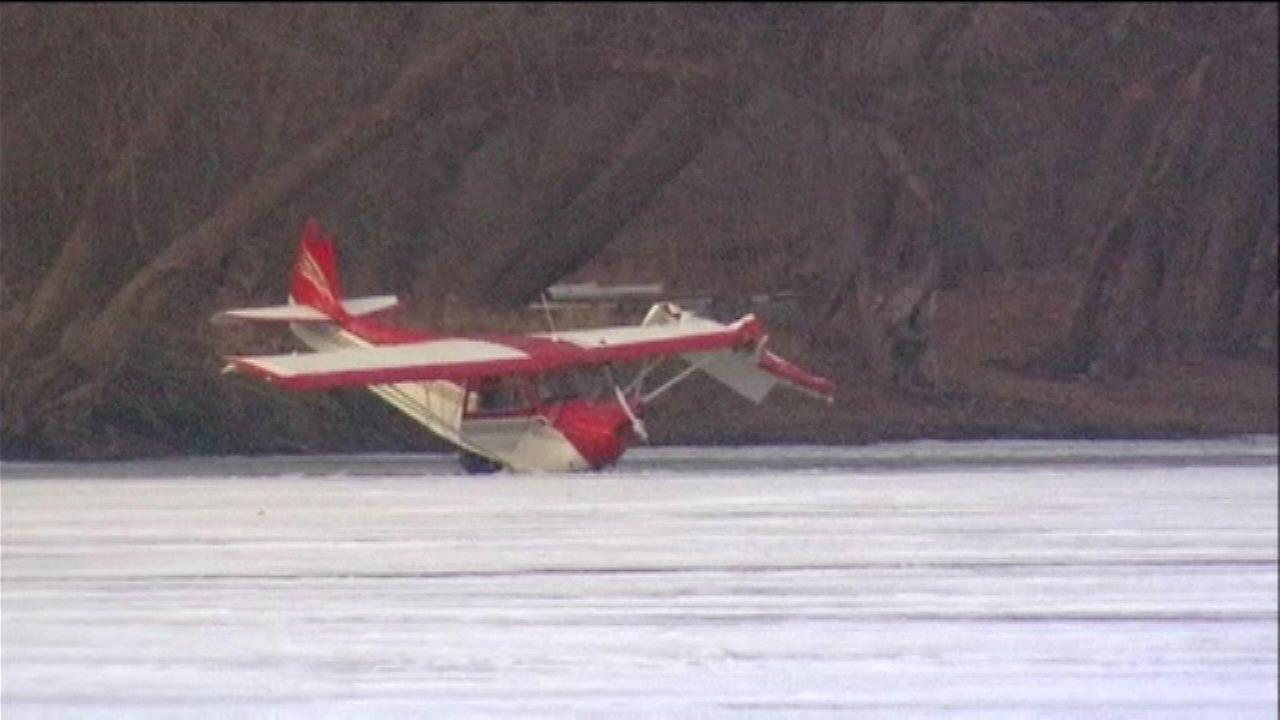 Small plane crashes onto frozen Rock River