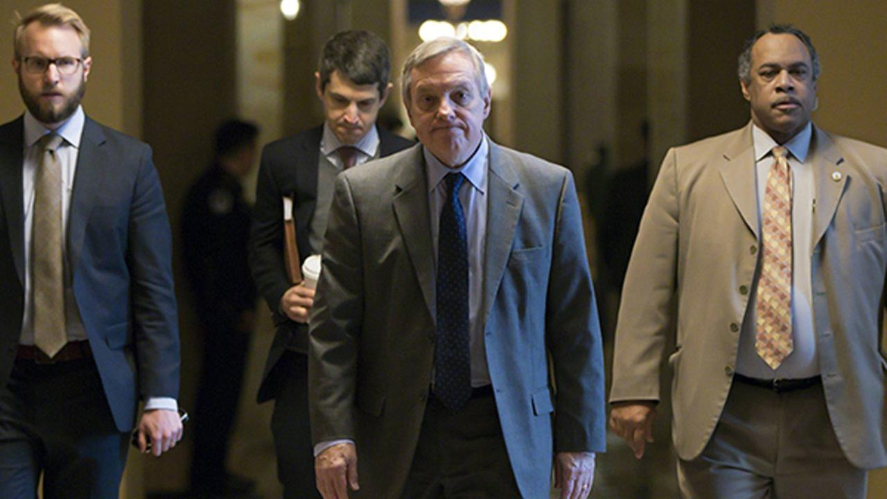 Sen. Dick Durbin of Illinois, the Senates No. 2 Democrat and his partys chief negotiator in immigration talks, walks to the chamber after a spending deal was reached.