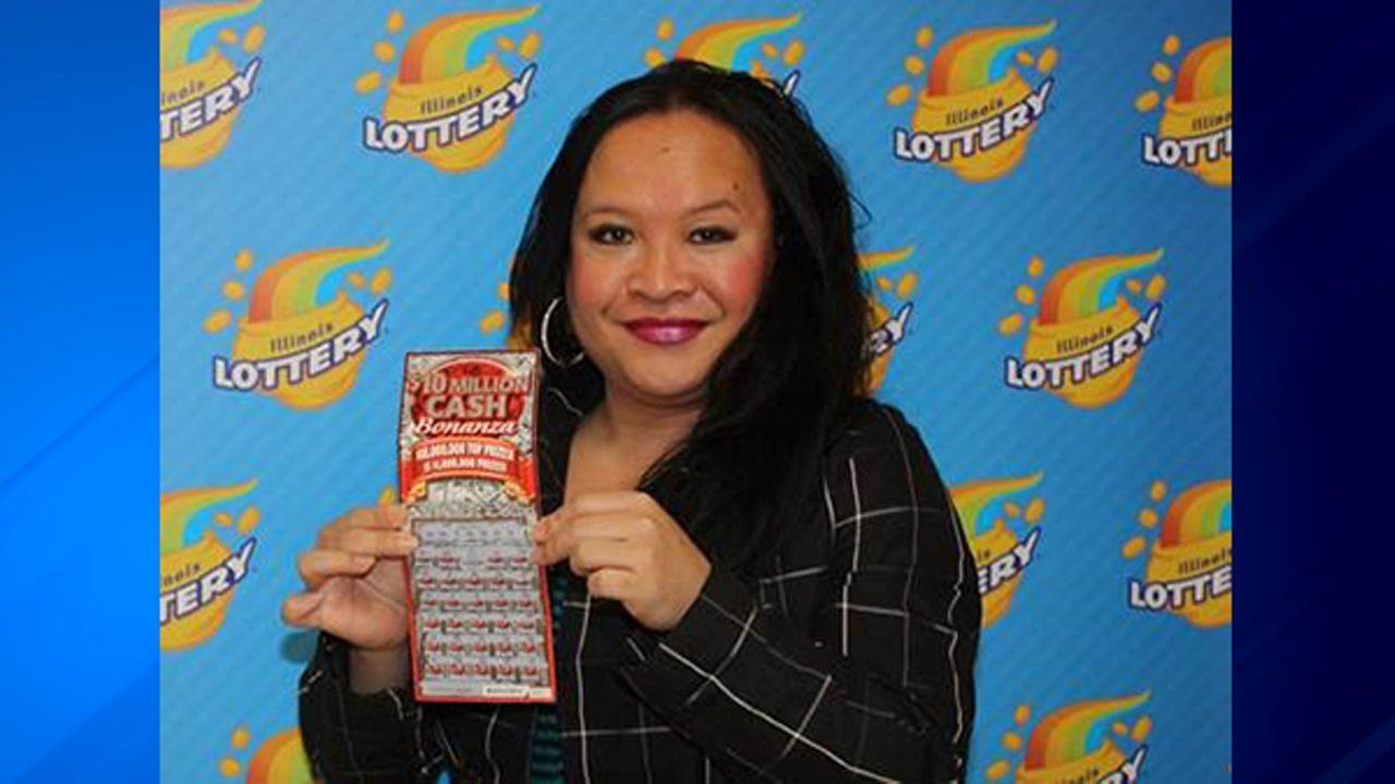Liyah Sangathit holds her winning $1 Million Cash Bonanza ticket.