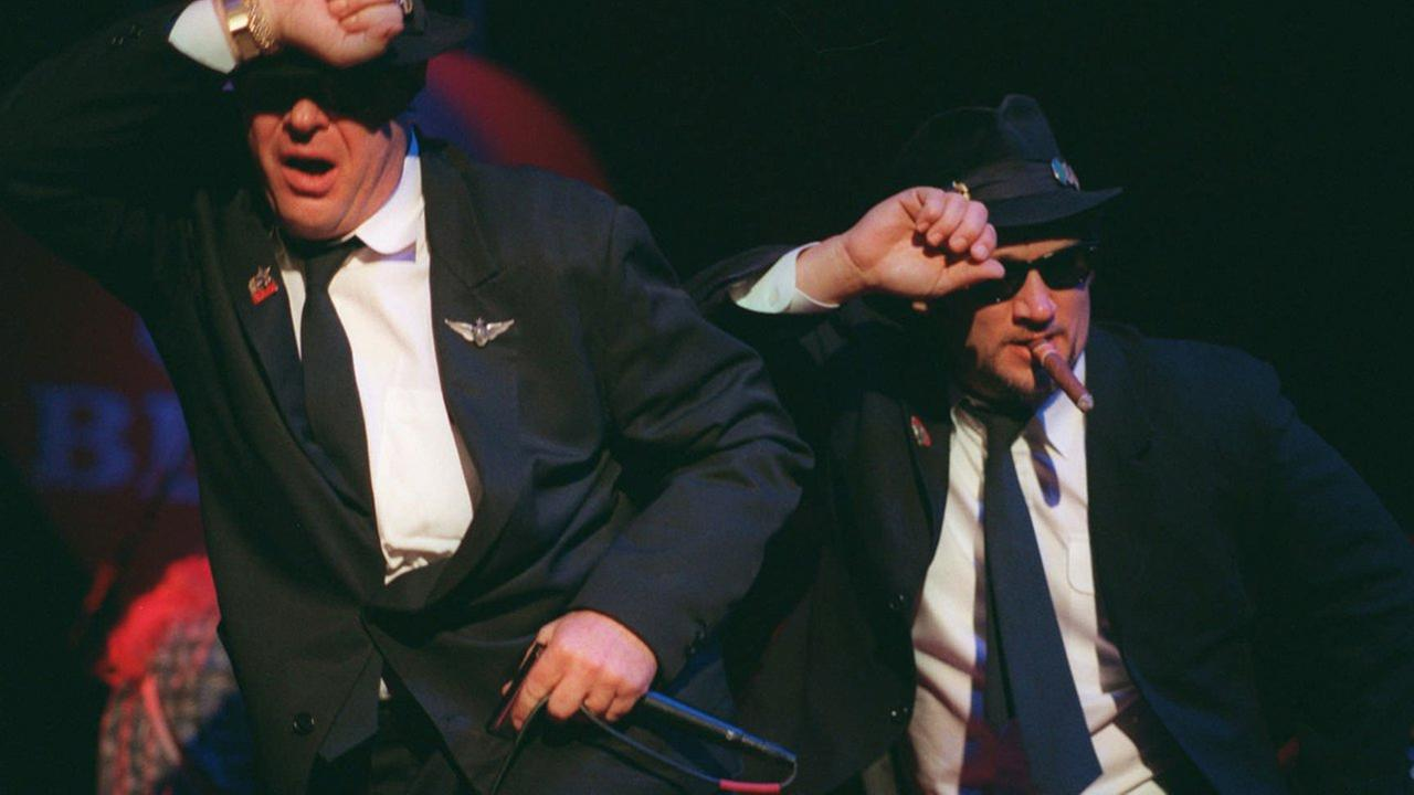 Actors Dan Aykroyd, left, and Jim Belushi perform as the Blues Brothers during the grand opening of the House of Blues restaurant and nightclub Nov. 24, 1996, in Chicago.